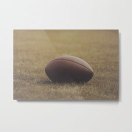 Football Resting in Grassy Turf Aged Effect Metal Print
