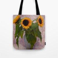 sunflowers Tote Bags featuring Sunflowers  by Guna Andersone & Mario Raats - G&M Studi