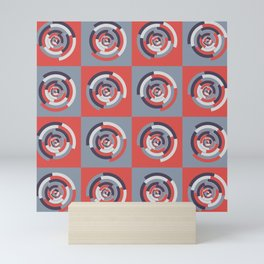 Spinning colourful rings on red and grey chessboard Mini Art Print