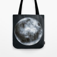 dark side of the moon Tote Bags featuring The Dark Side of the Moon by Viviana Gonzalez