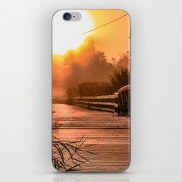 A beautiful sunrise view from a park footbridge iPhone Skin