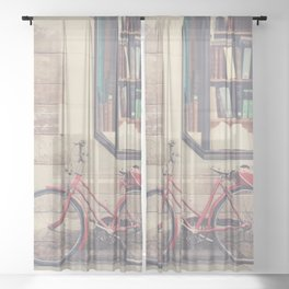 A vintage red bicycle and the bookstore photograph Sheer Curtain
