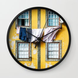 Beautiful and traditional facade of old building with clothes hanging from clothesline in windows. Wall Clock