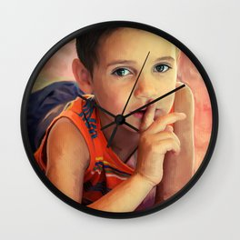 Hush - portrait of a boy with his finger to his lips Wall Clock