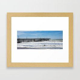 A Panoramic View Of Pismo Beach Pier, Surfers And Ocean Framed Art Print