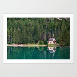 Chapel and trees are reflected in the water of Lake Braies Art Print