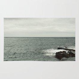 Watching the sea Rug