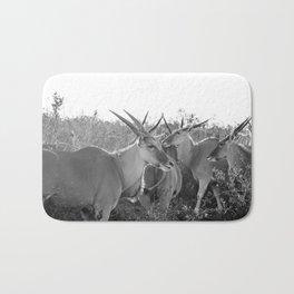 Herd of Eland stand in tall grass in African savanna Bath Mat