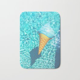 blue ice cream cone float all up in my pool yo Bath Mat