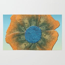 Orange flower on blue Rug