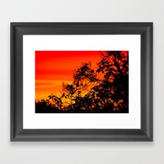 Silhouette of leaf with red autumn sky  Framed Art Print