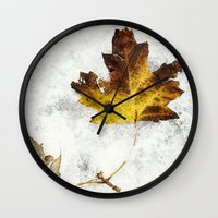 frozen Wall Clocks featuring frozen by Bonnie Jakobsen-Martin
