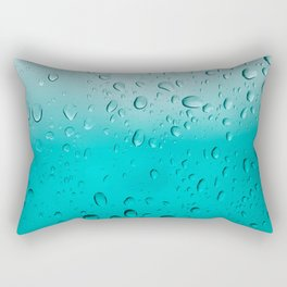 Real raindrops on window and turquoise background Rectangular Pillow