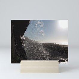 BEHIND THE WATERFALL ON A CORNWALL BEACH Mini Art Print