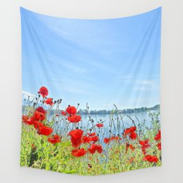 Red poppies in the lakeshore Wall Tapestry