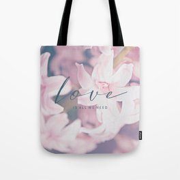 LOVE IS ALL WE NEED. TYPO ON FLORAL IMAGE BY SUBGRL Tote Bag