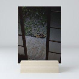Japanese Wooden Sandals in a Courtyard Garden Mini Art Print
