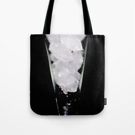 Icecubes in wine glass on black Tote Bag
