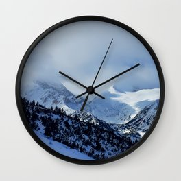 mountains under snow Wall Clock