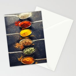 Colorful spices in metal spoons Stationery Cards