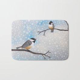 chickadees in snow Bath Mat