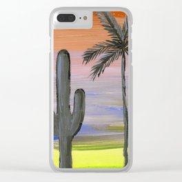 cactus and palm tree silhouette against a multi colored sky Clear iPhone Case