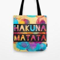 hakuna Tote Bags featuring Hakuna matata by Elisabeth Fredriksson