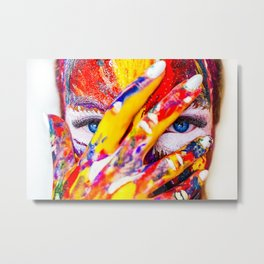 Women with paint on her hands and face Metal Print