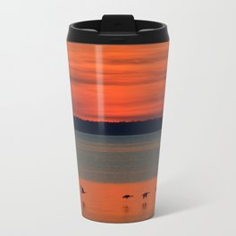 A flock of geese flying north across the calm evening waters of the bay Travel Mug