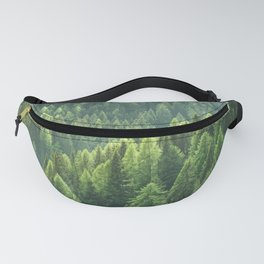 Pine tree forest in the morning fog Fanny Pack