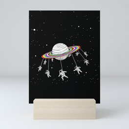 space carousel Mini Art Print