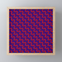 Chaotic pattern of blue rhombuses and red pyramids in a zigzag. Framed Mini Art Print