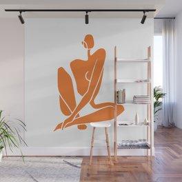 Sitting nude girl in orange Wall Mural