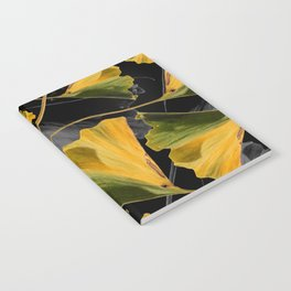 Yellow Ginkgo Leaves on Black Notebook