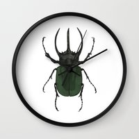 atlas Wall Clocks featuring Atlas Beetle Insect Digital Watercolor Painting Art Print- minimalist art - gallery wall art - anima by Kelsi Eldredge