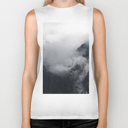 White clouds over the dark rocky mountains Biker Tank