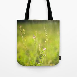 Wild flowers in the green meadow Tote Bag