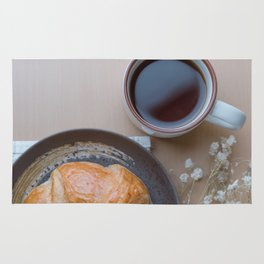 Croissant and black coffee Rug
