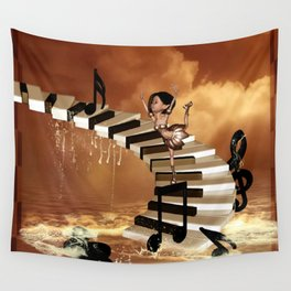Cute little girl dancing on a piano Wall Tapestry