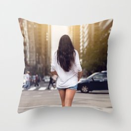 Beautiful girl with long legs walking around New York City street wearing jeans shorts. Rear view. Throw Pillow