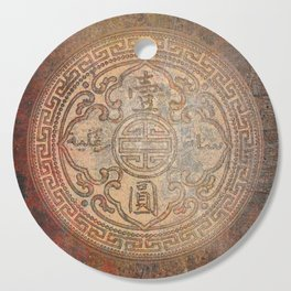Antic Chinese Coin on Distressed Metallic Background Cutting Board