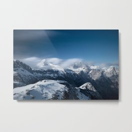 Clouds rolling above snowy mountains Metal Print