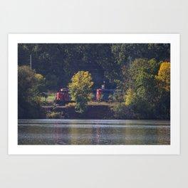 Train traveling along river Art Print