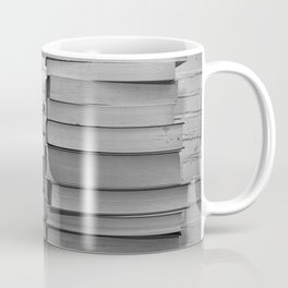 Black and white image of some books stacked on a shelf Coffee Mug