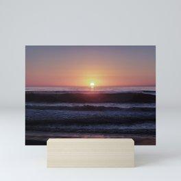 Colorful sunset at a beach Mini Art Print