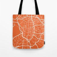 madrid Tote Bags featuring Madrid Map by Studio Tesouro