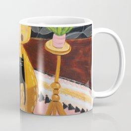 black cat on mustard yellow sofa painting by Tascha Coffee Mug