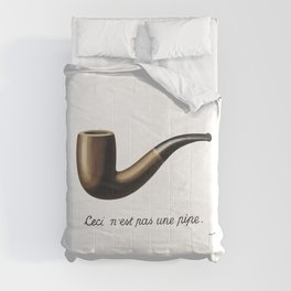 The Treachery of Images by Rene Magritte Comforters