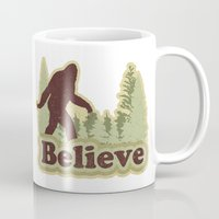 bigfoot Mugs featuring Bigfoot Believe by Heather Green