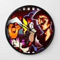 grafitti Wall Clocks featuring Grafitti Strip Film by Squint Photography